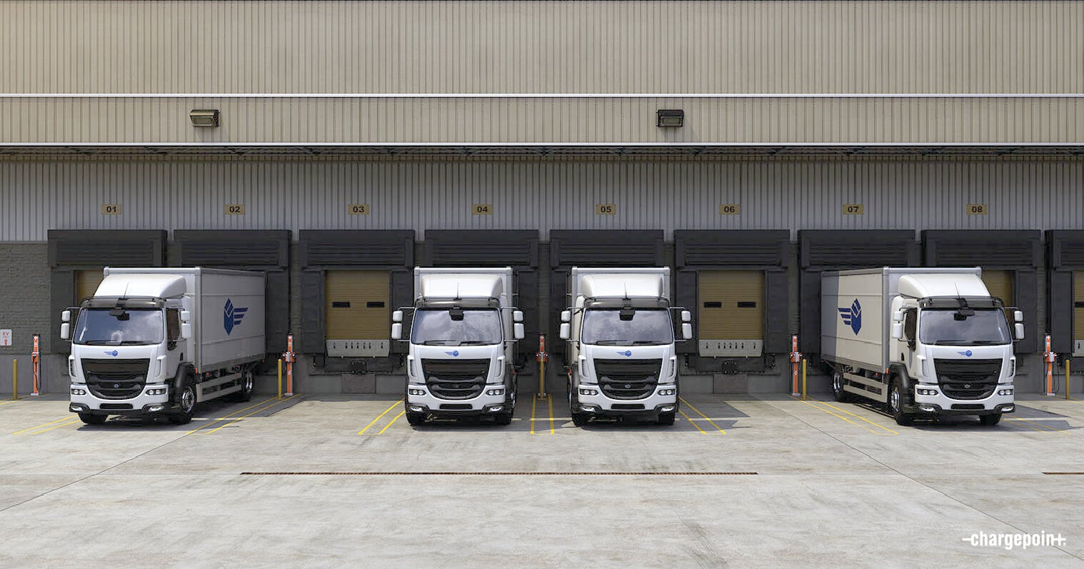 Electric delivery fleet vehicles in depot