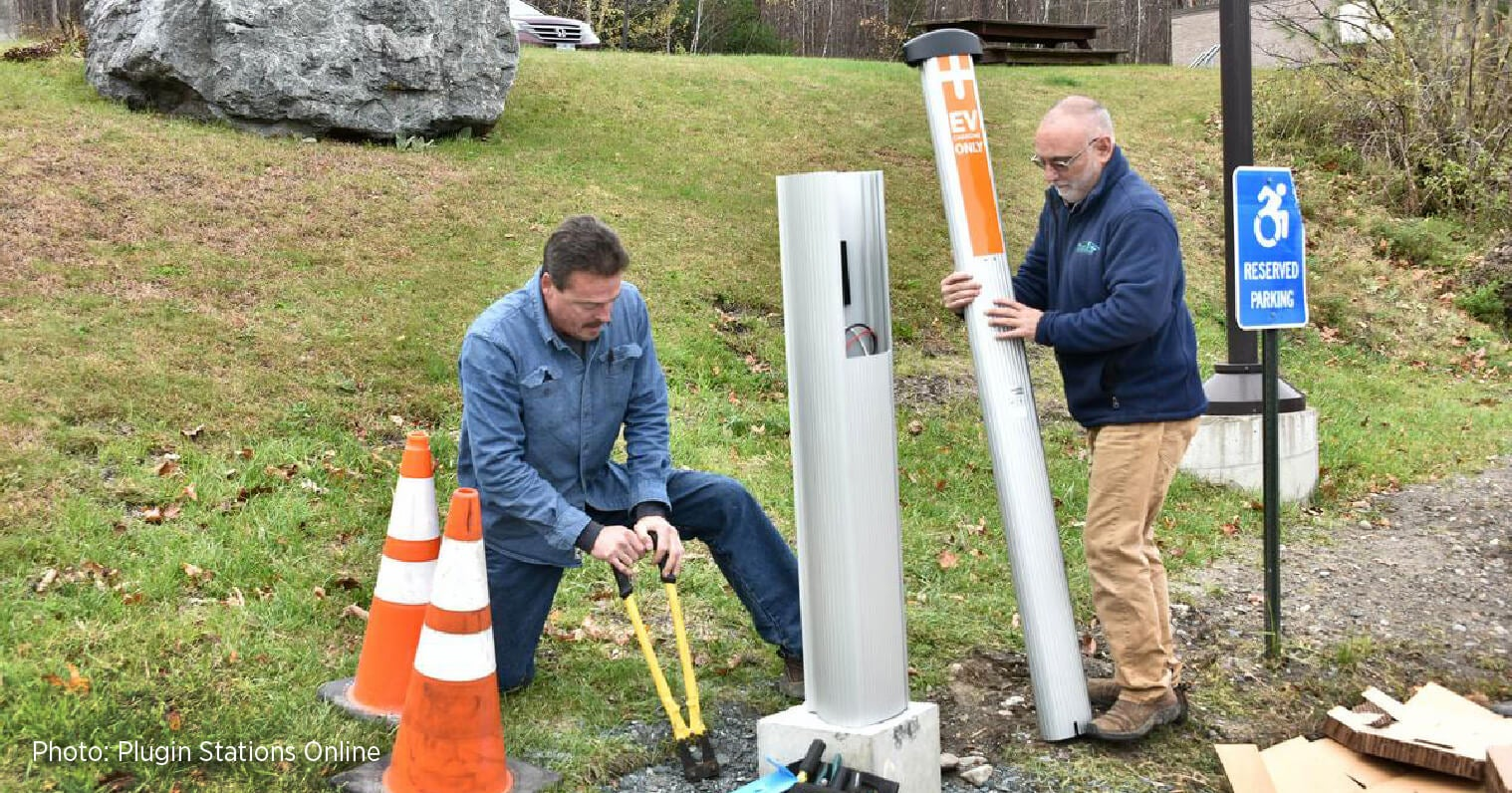 John Doran and an employee installing a ChargePoint station